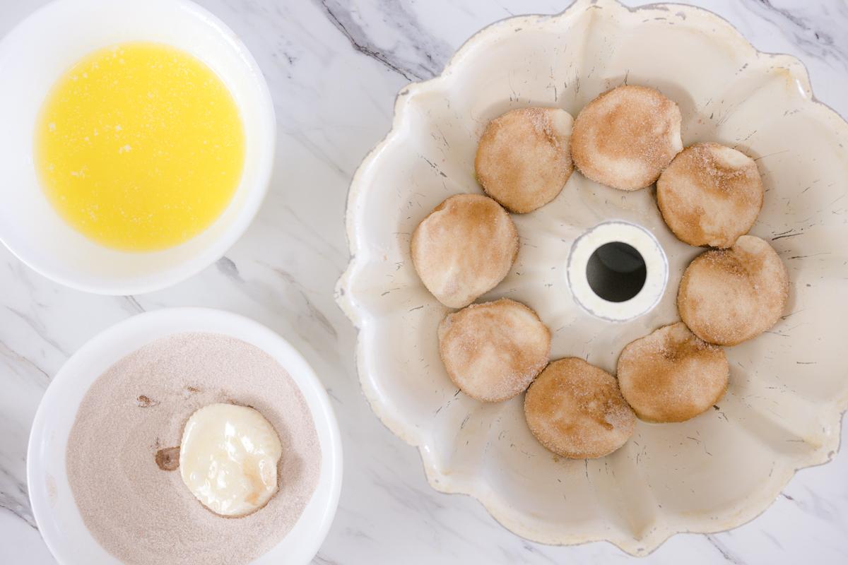 placing biscuits into bundt pan
