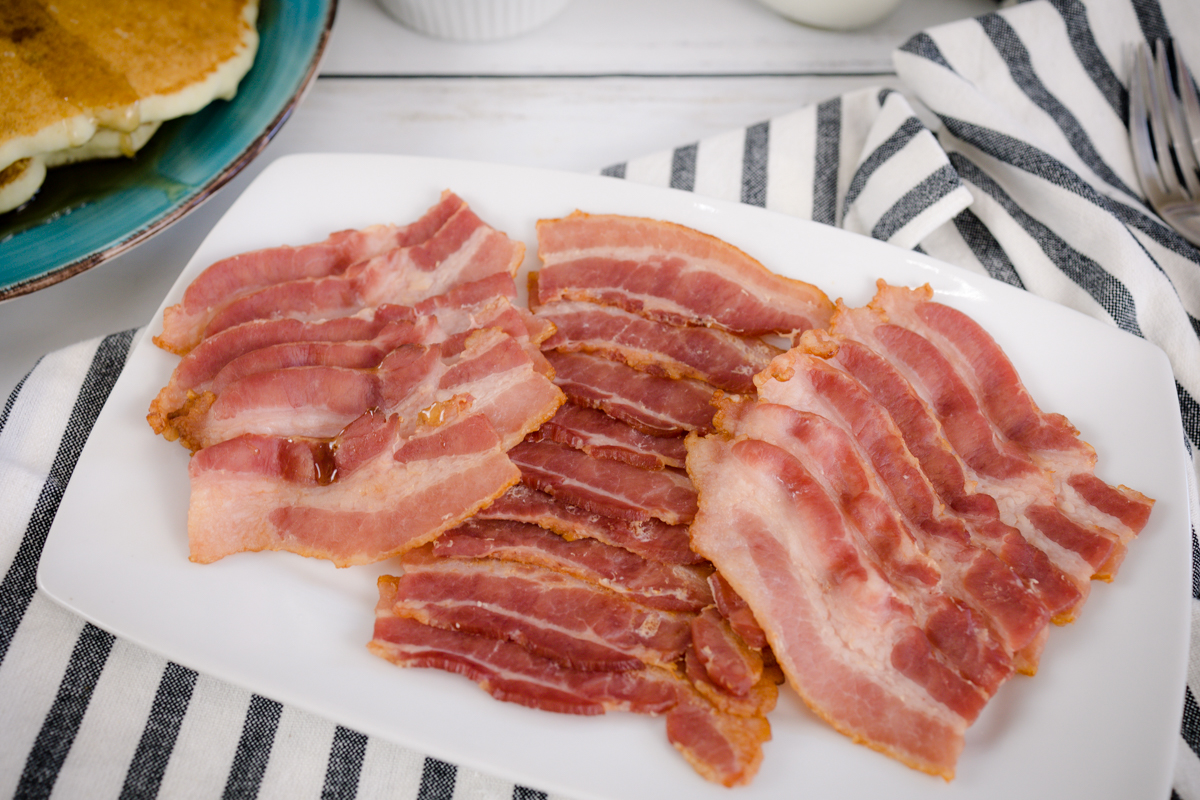 Oven baked bacon on plate
