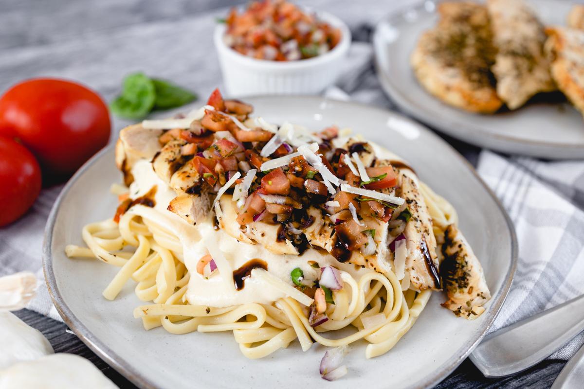 Bruschetta Chicken with Balsamic Glaze over Pasta