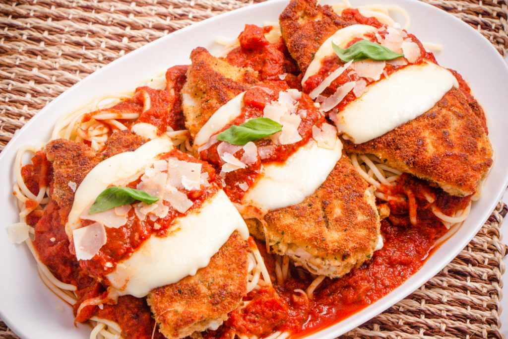 Baked Chicken Parmesan on plate with pasta