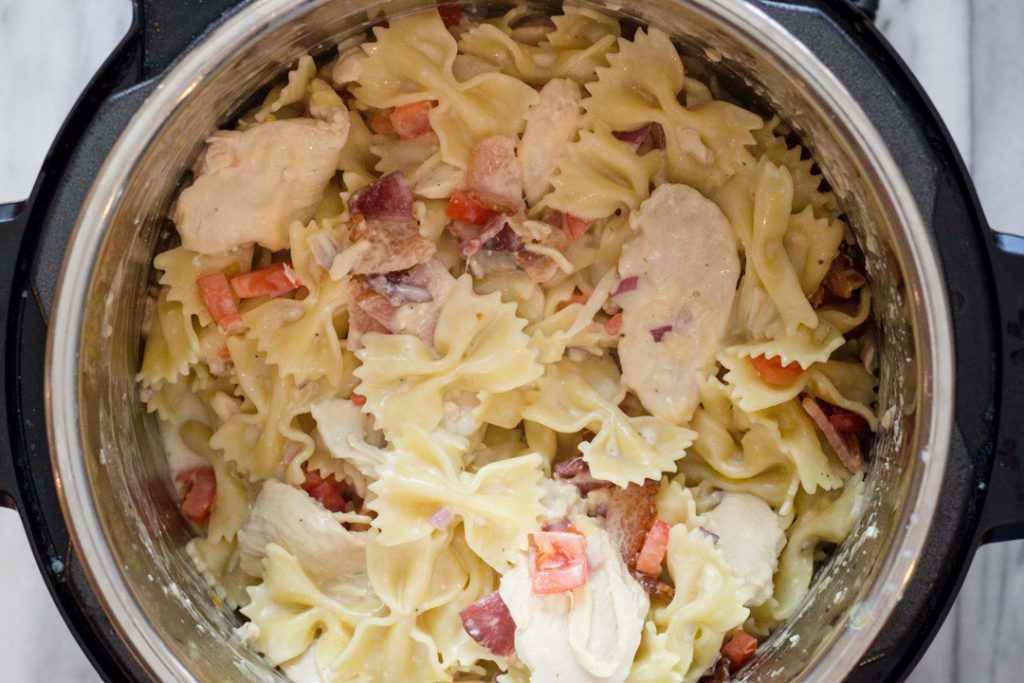 Chicken Carbonara_Bowtie Festival Pasta_with Bacon, tomatoes, red onion in a creamy alfredo sauce
