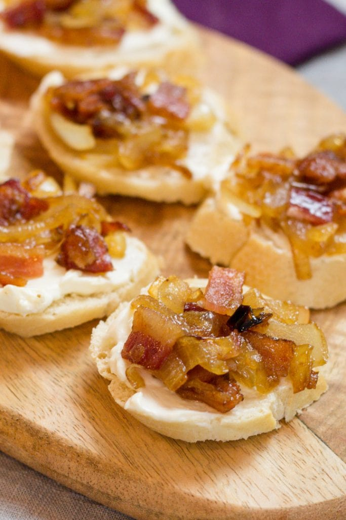 Sweet and Savory Appetizer made with Bacon and Sauteed Onions on a toasted Bagel Chip