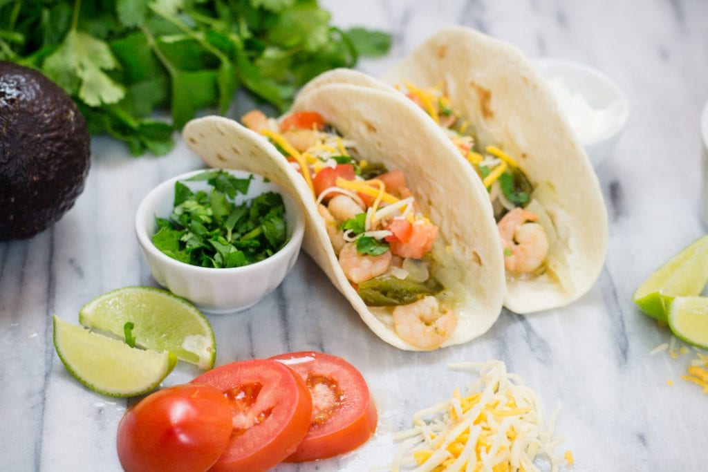 Cilantro Lime Shrimp Tacos with Tomato, lime, cheese, avocado