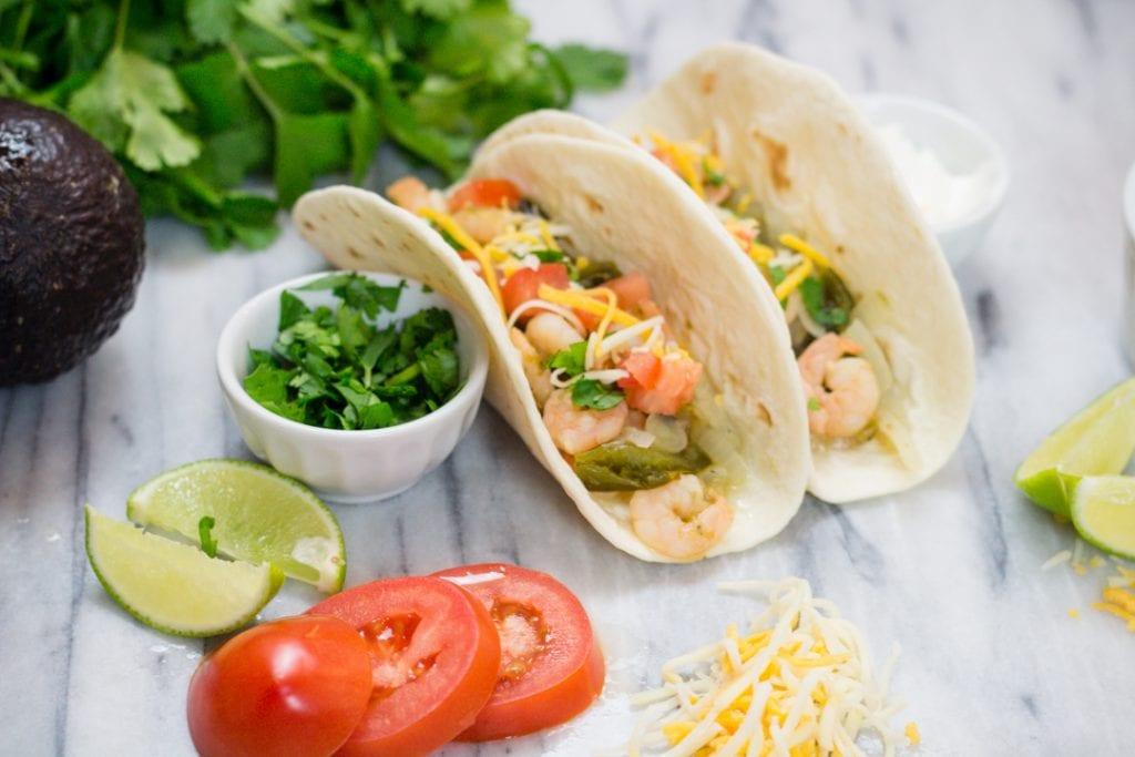 Cilantro Lime Shrimp Tacos with Tomato, lime, cheese, avocado