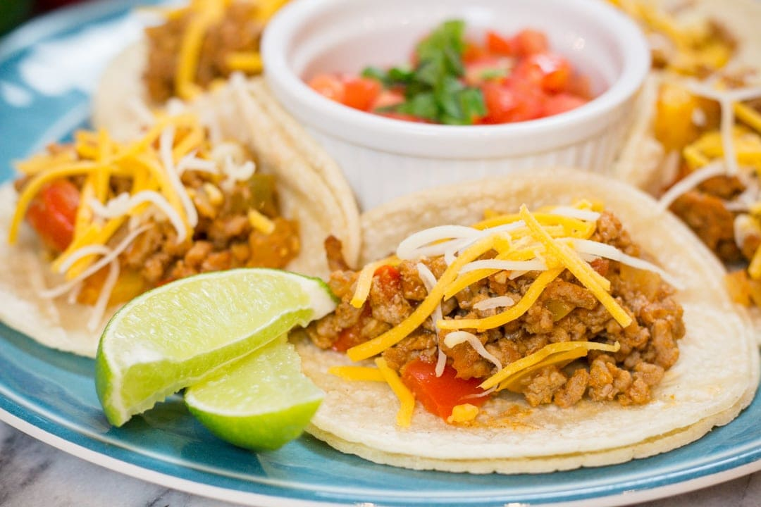 Who doesn't love a good Taco in their hand? Ground Turkey Tacos are Keto Friendly, Gluten Free and perfect for Taco Tuesday. Instant Pot recipe makes this a perfect recipe for any night of the week with fresh bell peppers, limes, cilantro, tomatoes and more this recipe is a healthy feel good recipe to enjoy. #tacotuesday #taco #groundturkeytaco #groundturkey #glutenfree #keto #ketofriendly #dinner #dinnerrecipe #easyrecipe #food #foodie #recipe #recipes #instantpot #instantpotrecipe #yum