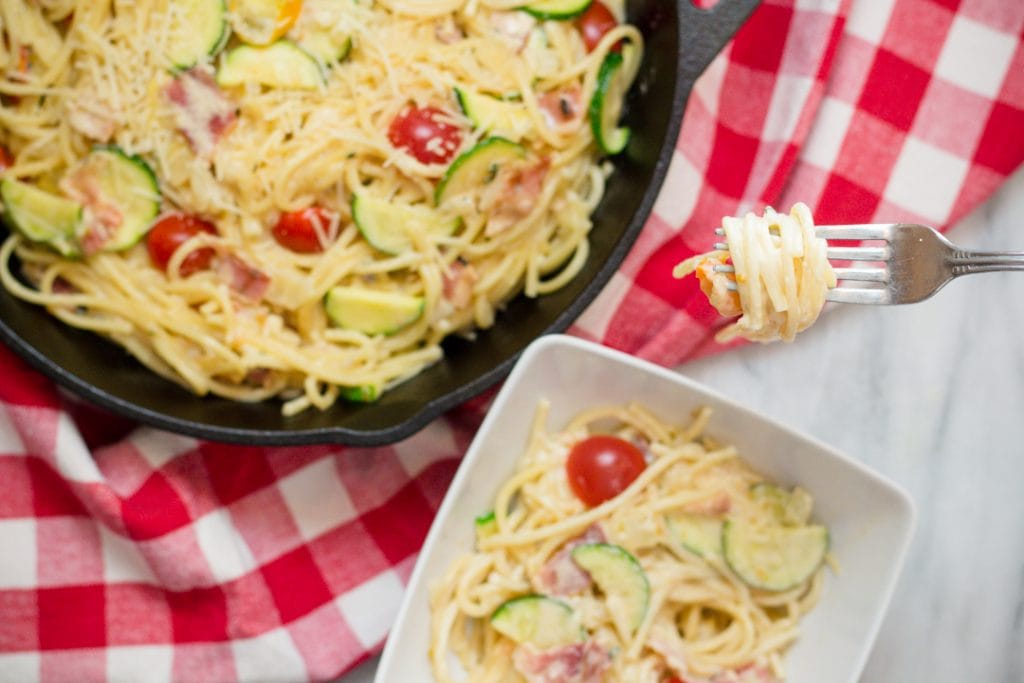 Fork full of pasta with Zucchini and Cheery Tomatoes