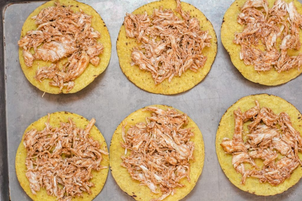 BBQ Chicken on Tostada Shell on baking sheet
