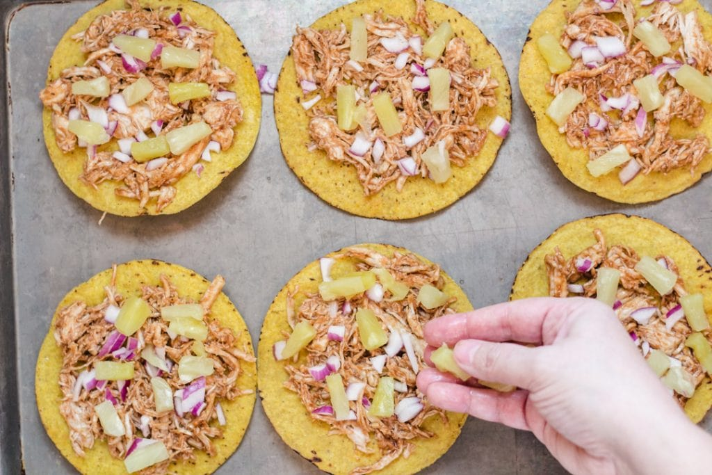 BBQ Chicken Tostada with Red Onions and Pineapple on top