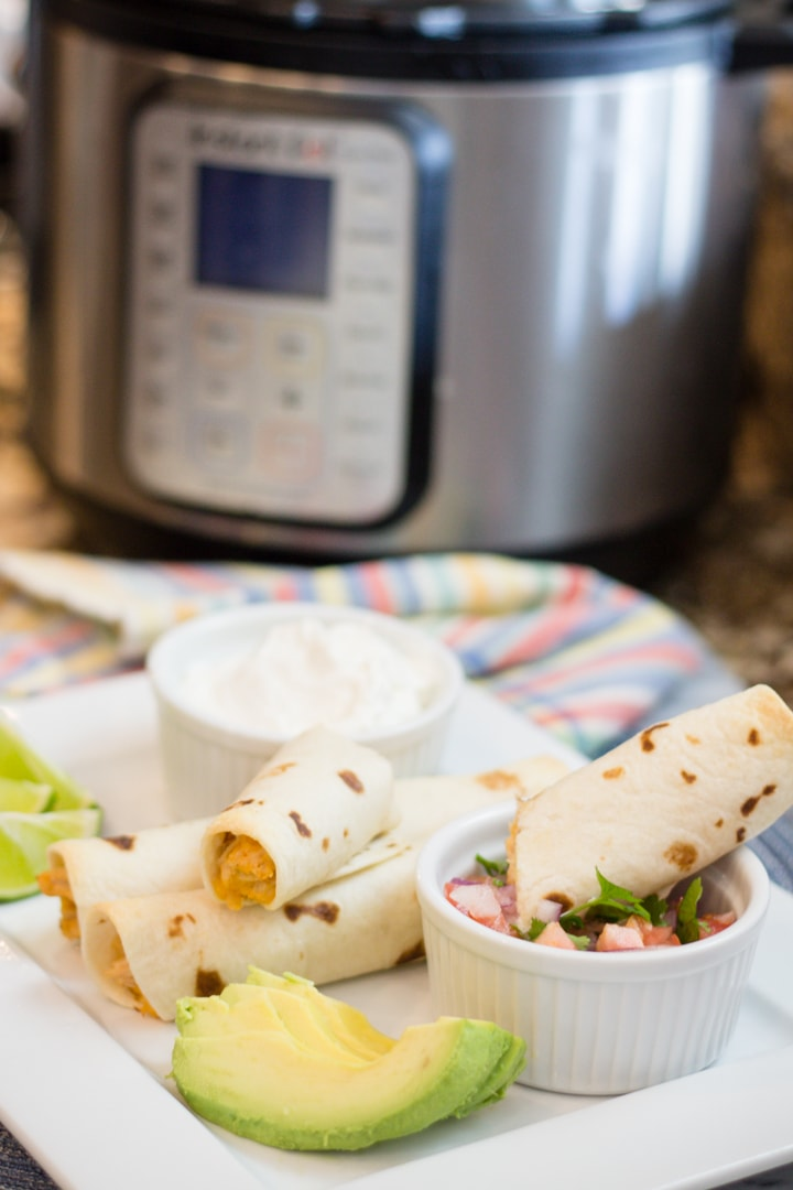 Family Favorite and Kid Approved Homemade Chicken Taquitos. Make Shredded Chicken in the Instant Pot and throw together these delicious Taquitos for your next meal. We love how creamy and delicious these Chicken Taquitos are. #devourdinner #taquitos #Chicken #chickentaquitos #easyrecipe #chickenrecipe #kidapproved #familyrecipe #yum #food #foodie #recipe #recipes