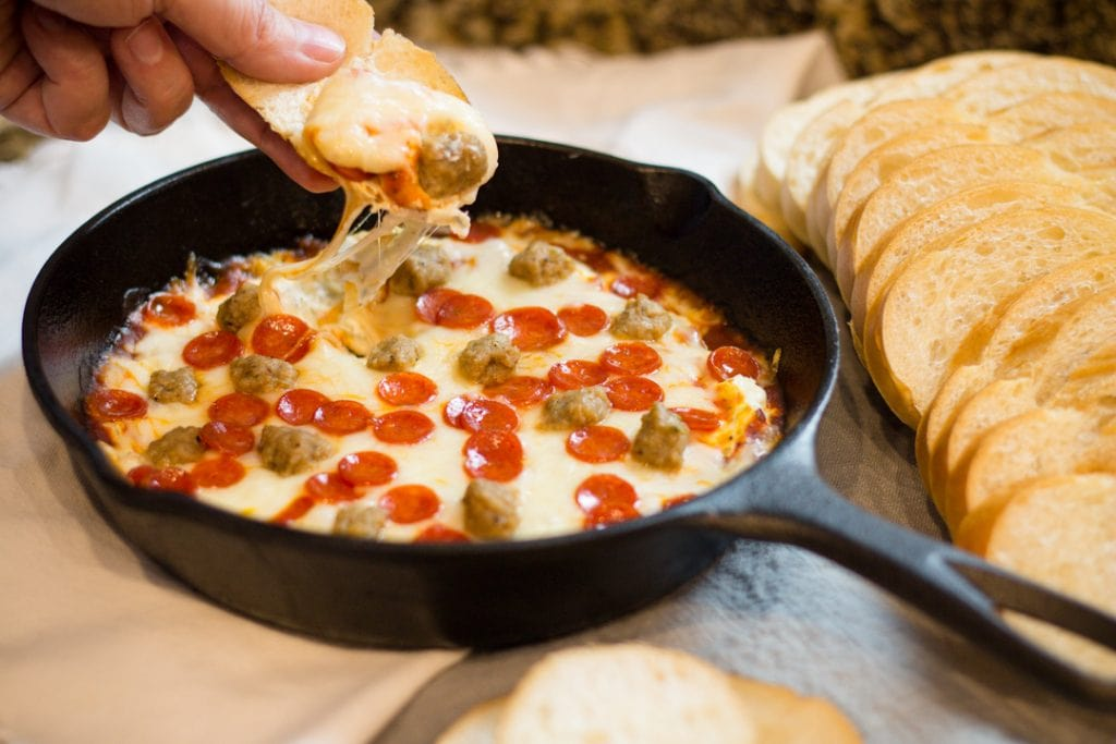 Easy Pizza Dip with Pepperoni and Sausage on bread