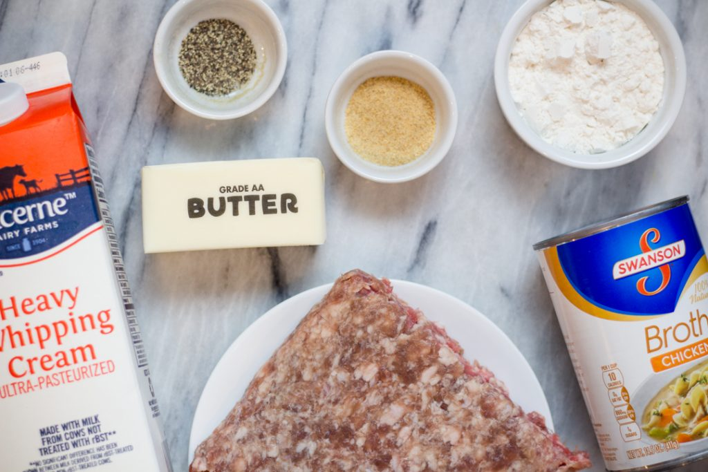 Sausage Gravy Recipe Ingredients on marble cutting board