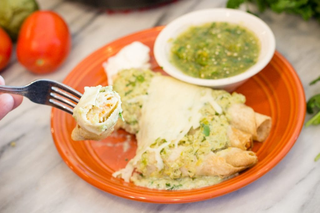Chicken Taquito with Creamy Tomatillo Salsa and melted cheese