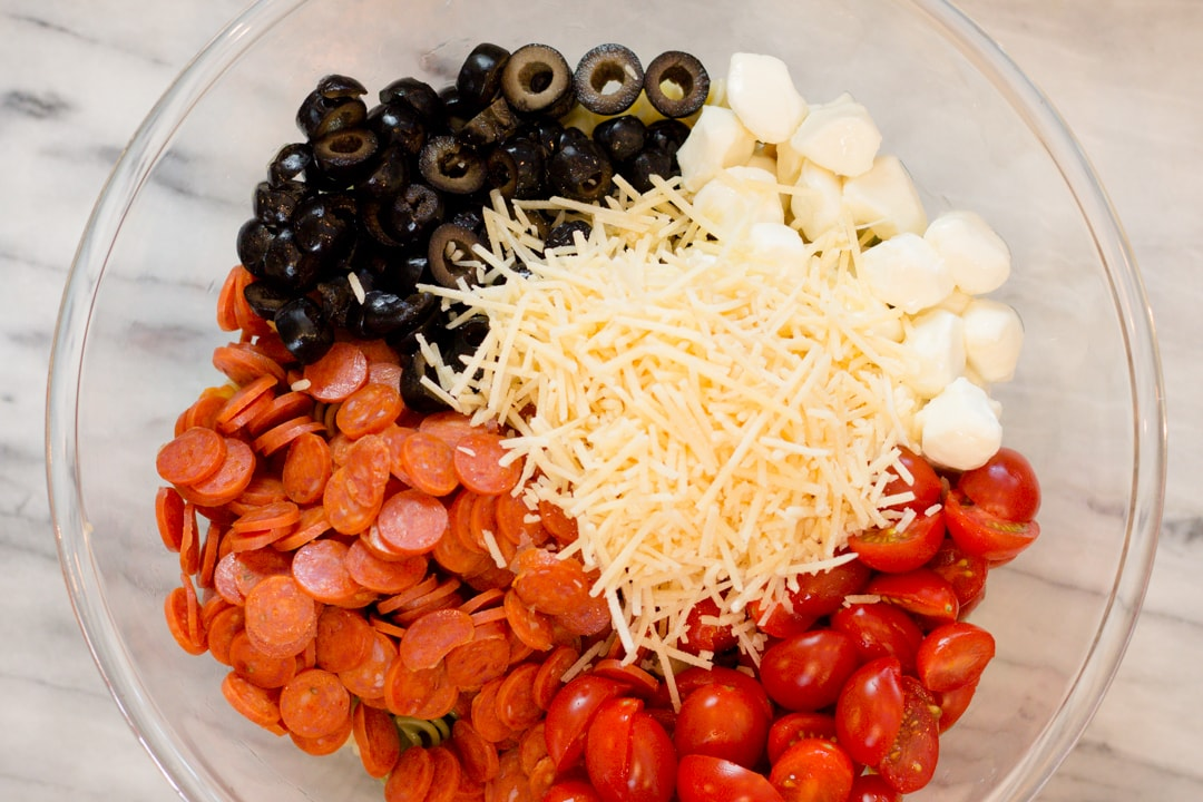 bowl with Cheese, Pepperoni, Olives, Tomatoes for Pepperoni Pasta Salad