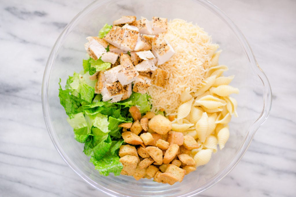 Pasta, Chicken, Salad, Croutons, Cheese in a bowl