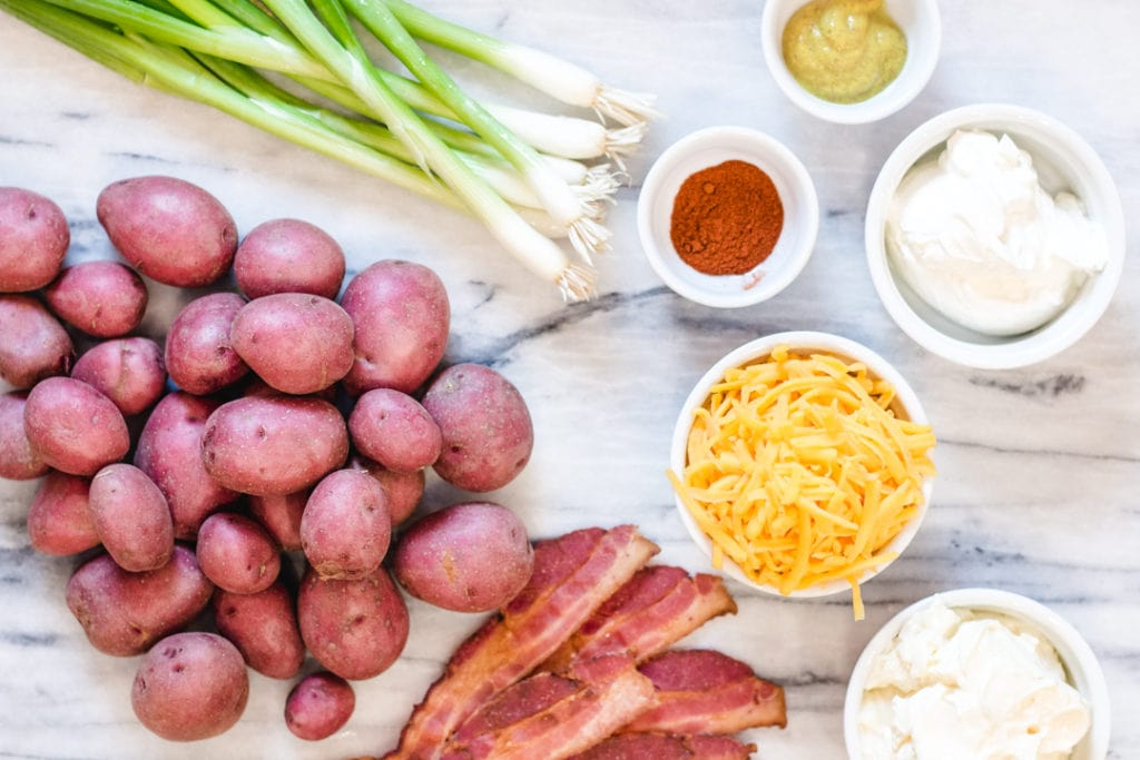 Red Potatoes, bacon, cheese, green onions ingredients for Baked Potato Salad Recipe