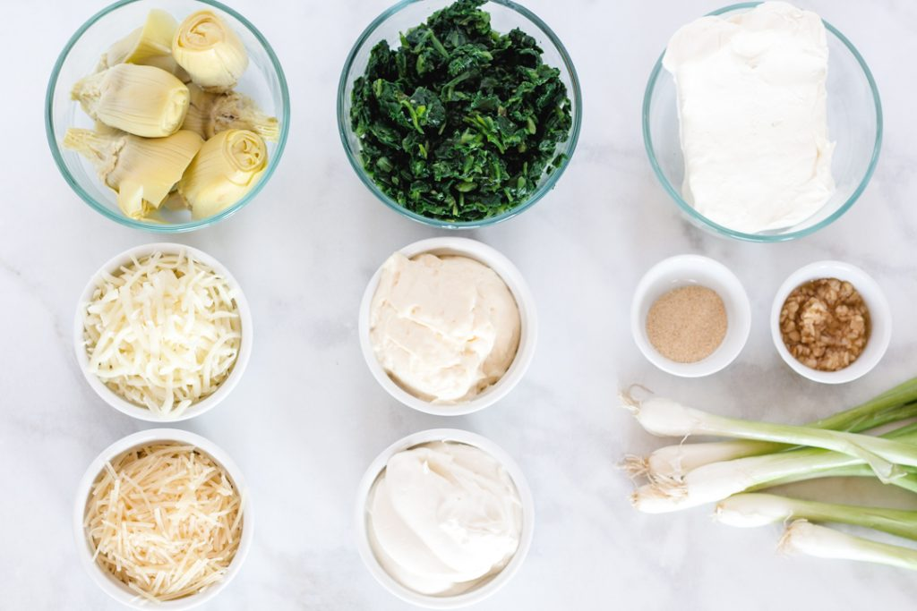 Flat lay ingredients for Spinach Artichoke Dip