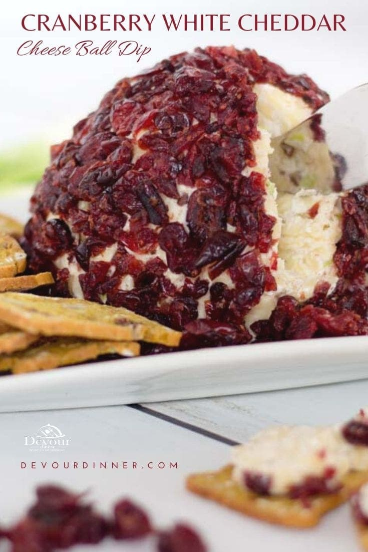 White Cheddar Cranberry Cheese Ball is a mouthful to say but you won't have a chance to say it because your mouth will be full. This cheeseball brings you the delicious and festive flavors of winter in a unique twist on a traditional appetizer that will no doubt begin gracing your table during the holidays.