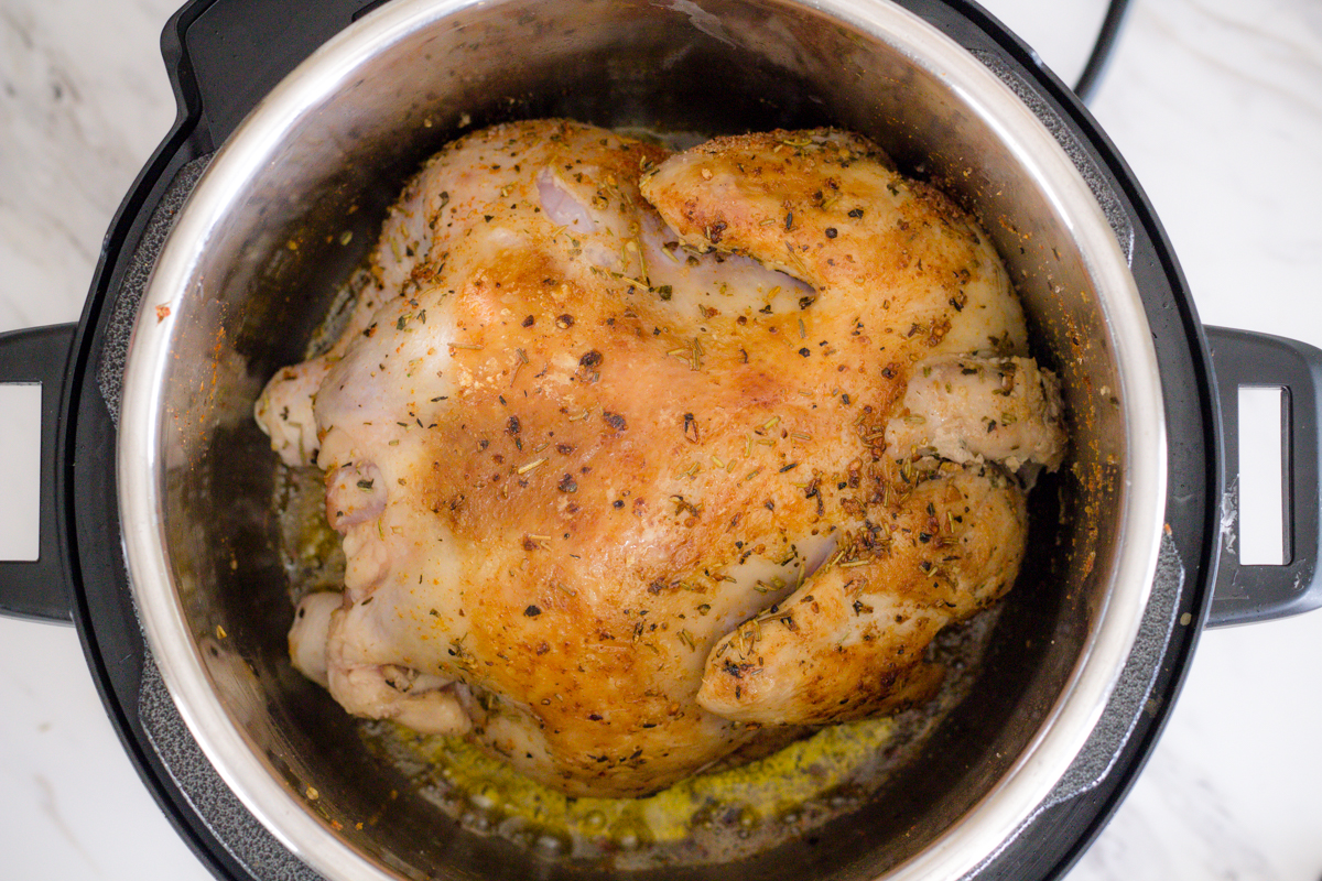 Sear whole chicken in Instant Pot