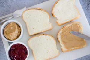 Spreading Peanut Butter on Bread