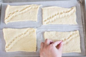 Pinching seams of crescent rolls