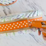 Adding Ribbon to Diaper Cake with Hot Glue Gun