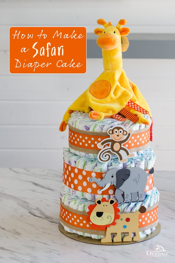 Make an adorable Safari Baby Diaper Cake with step by step instructions. Safari Themed but easily change to a theme you want too. Three Tier Baby Diaper Cake made with diapers, wipes, ribbons, and embellishments for a center piece or gift to your favorite baby mama. #diapercake #safaridiapercake #babydiapercake #babymama #howtomakediapercake