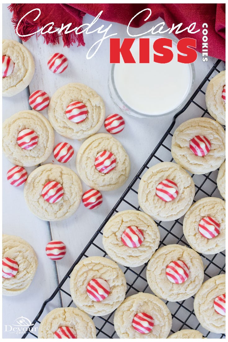 A Kiss of Peppermint in these Peppermint Kiss Cookies for all your holiday needs. Red and White Striped Hershey Kisses are perfect when topped on these soft and chewy Sugar Drop Cookies. Candy Cane Cookies are a fun holiday treat. Who doesn't love the crunch of peppermint in a yummy cookie. I sure do! #devourdinner #devourpower #easyrecipe #recipeoftheday #YummyInMyTummy #onmyplate #foodtime #huffposttaste #foodforthought #abmfoodie #candycanecookies #peppermintkisscookies #cookierecipe