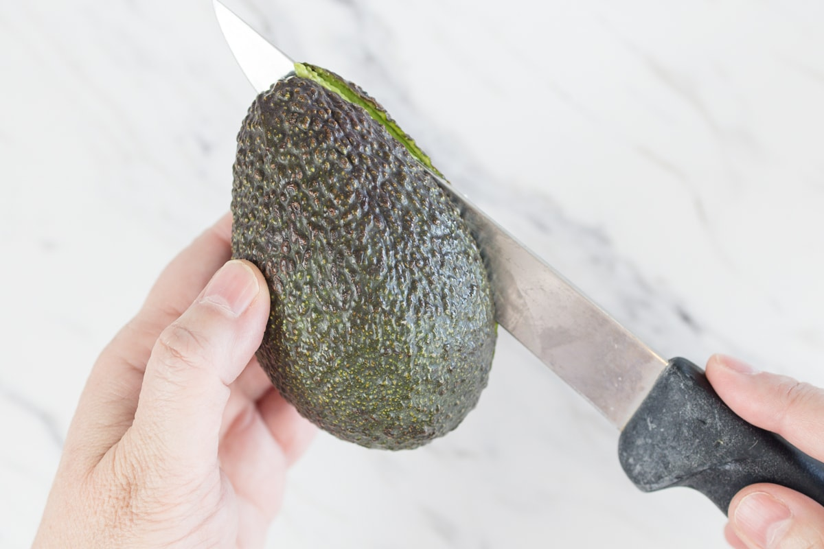 Slice Avocado in Half and twist to separate