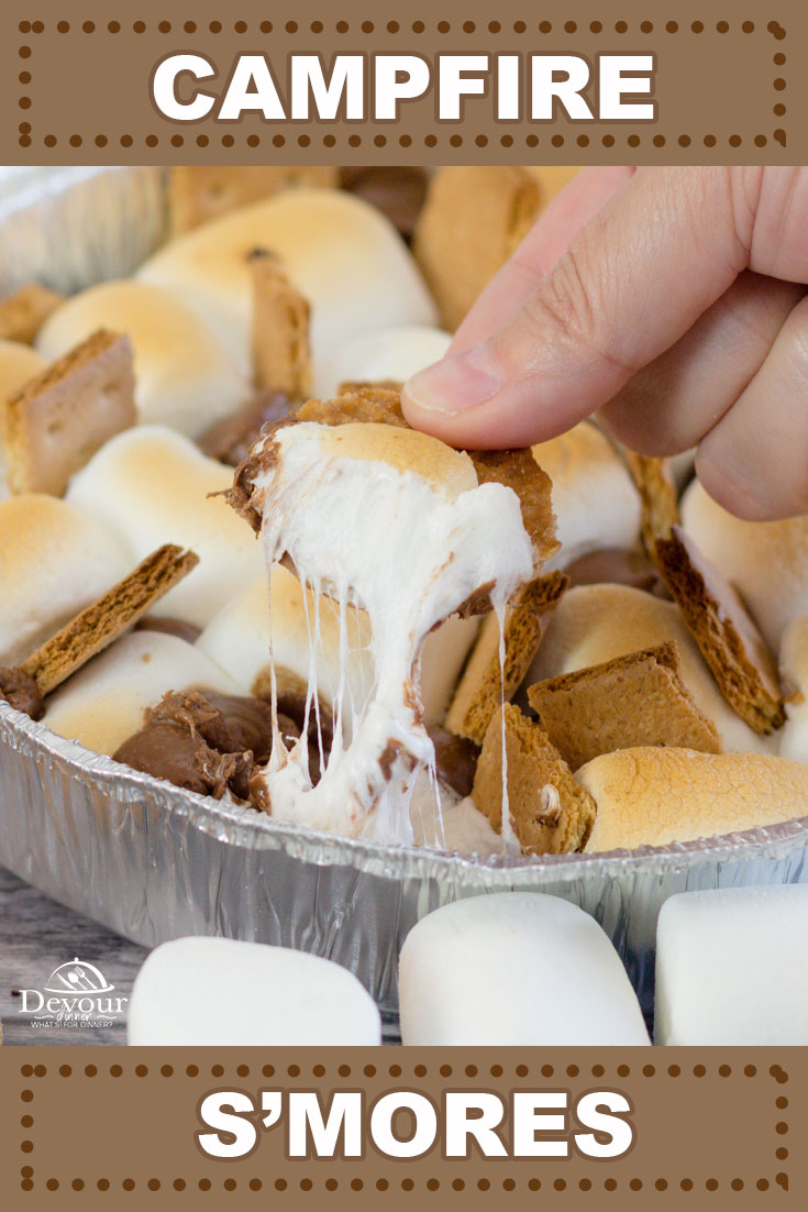 Forgot your roasting sticks? No problem with these Campfire S'mores made in a Foil Tin pan. Everyone can dive into these Campfire Nachos. Big or small crowd, no problem! Making Campfire S'mores is fun, quick and easy. Loaded with Marshmallows, Kisses, Rolos and Grahams. #devourdinner #devourpower #smores #smoresdessert #campfiresmores #easydessert #easyrecipe #camping #campingrecipe #familyrecipe #iammartha #foodiefriday #buzzfeast #marshmallows #campingmeals #campfire