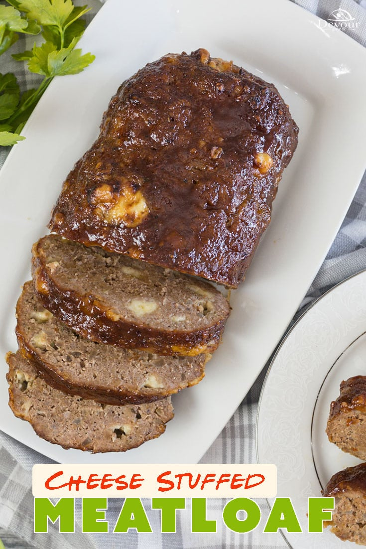 Perfectly Seasoned Cheese Stuffed Meatloaf made with ground pork and ground sirloin for a delicious combination of flavors. Stuffing a meatloaf is easy and oh so good. Use Cheddar Cheese or your favorite blend of cheeses in this Homemade Stuffed Meatloaf Recipe. Bake in 2 smaller loaves is perfect for leftovers. #devourdinner #devourpower #meatloaf #cheesestuffedmeatloaf #familyrecipe #easyrecipe #beeffordinner #iammartha #buzzfeed #dinnerrecipe #bakedmeatloaf #yum #yummy #familyfavorite