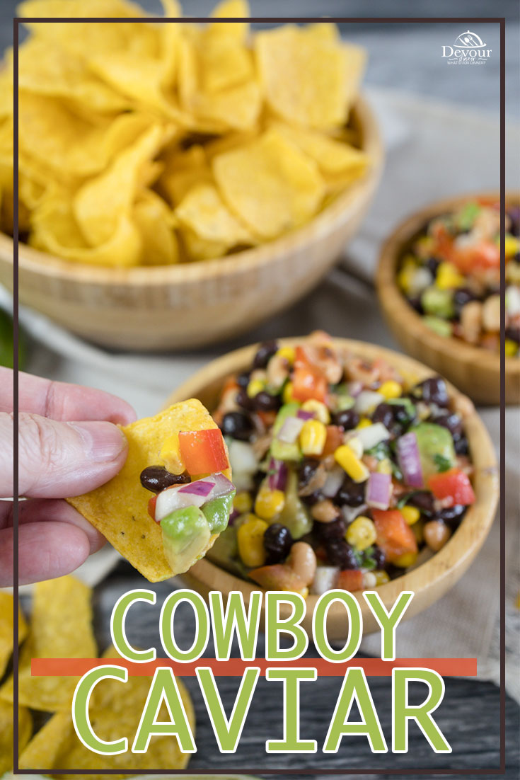 Cowboy Caviar, BBQ Potluck Favorite and tried and true recipe. Perfect addition for any meal this delicious bean and avocado dip is a 5 Star Recipe. Serve with Tortilla Chips or as a side to your favorite recipe. Easily made and enjoyed. Spice up with Anaheim or Jalapeno Pepper. #devourdinner #devourpower #cowboycaviar #avocadobeandip #iammartha #BBQWeek #BBQRecipe #Potluck #SummerDip #Salsa #buzzfeast #yum #yummy