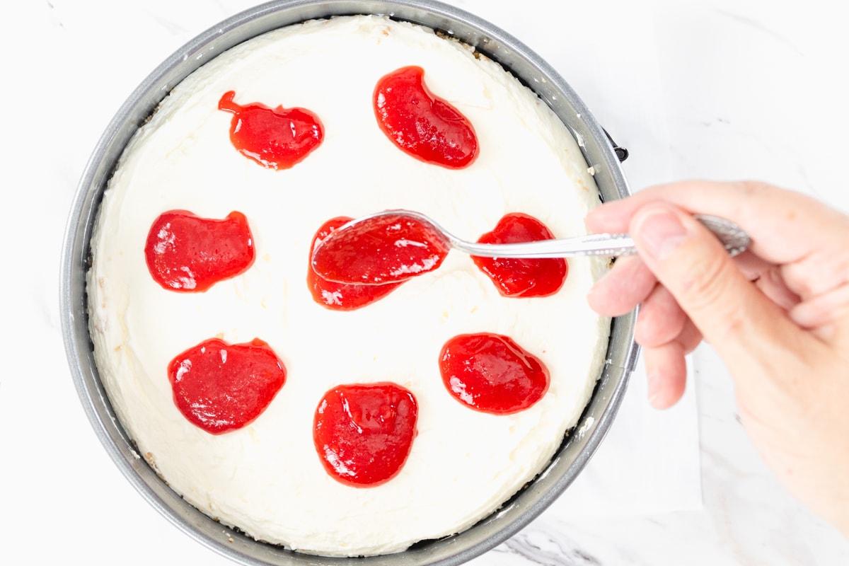Raspberry Puree on Cheesecake