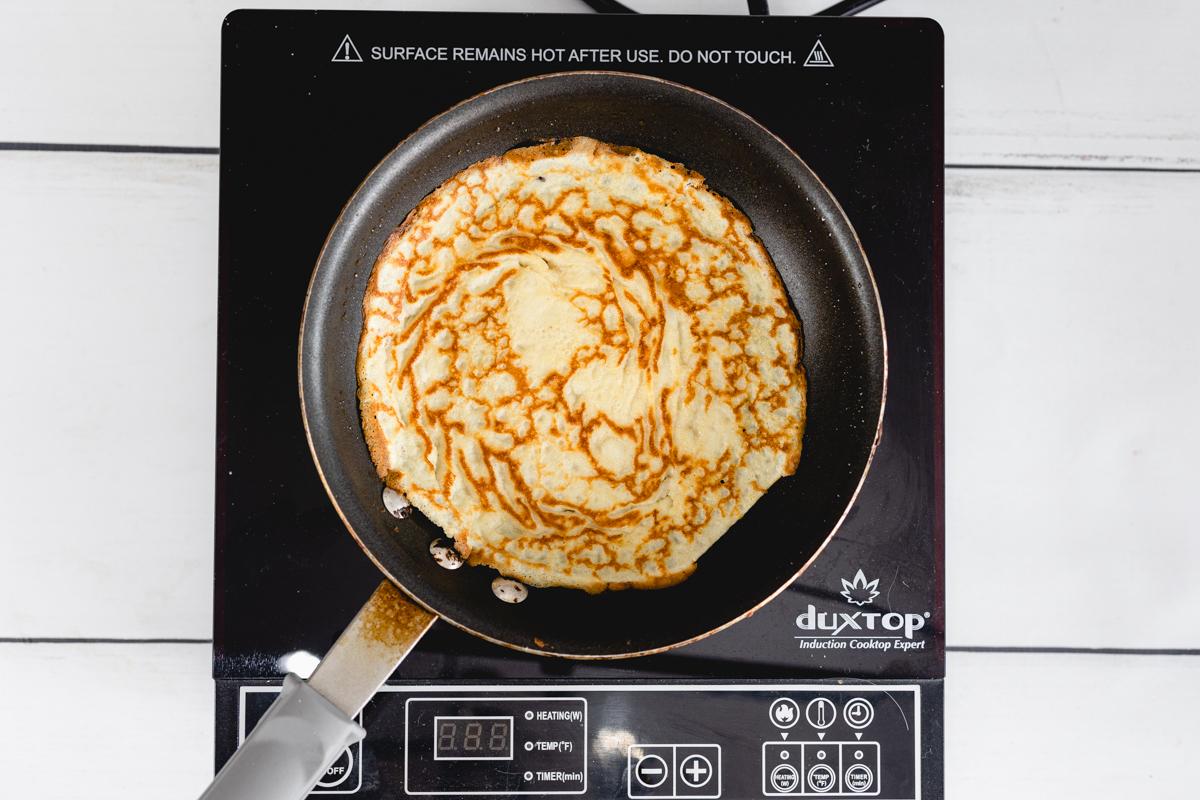 Crepe batter in frying pan