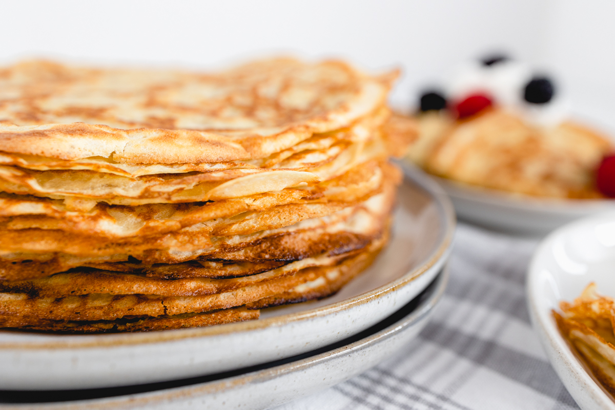 Crepes stacked on plate