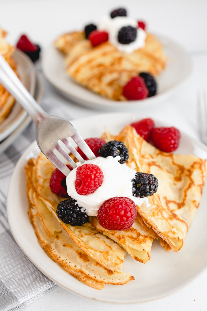 Crepes with whipping cream and berries