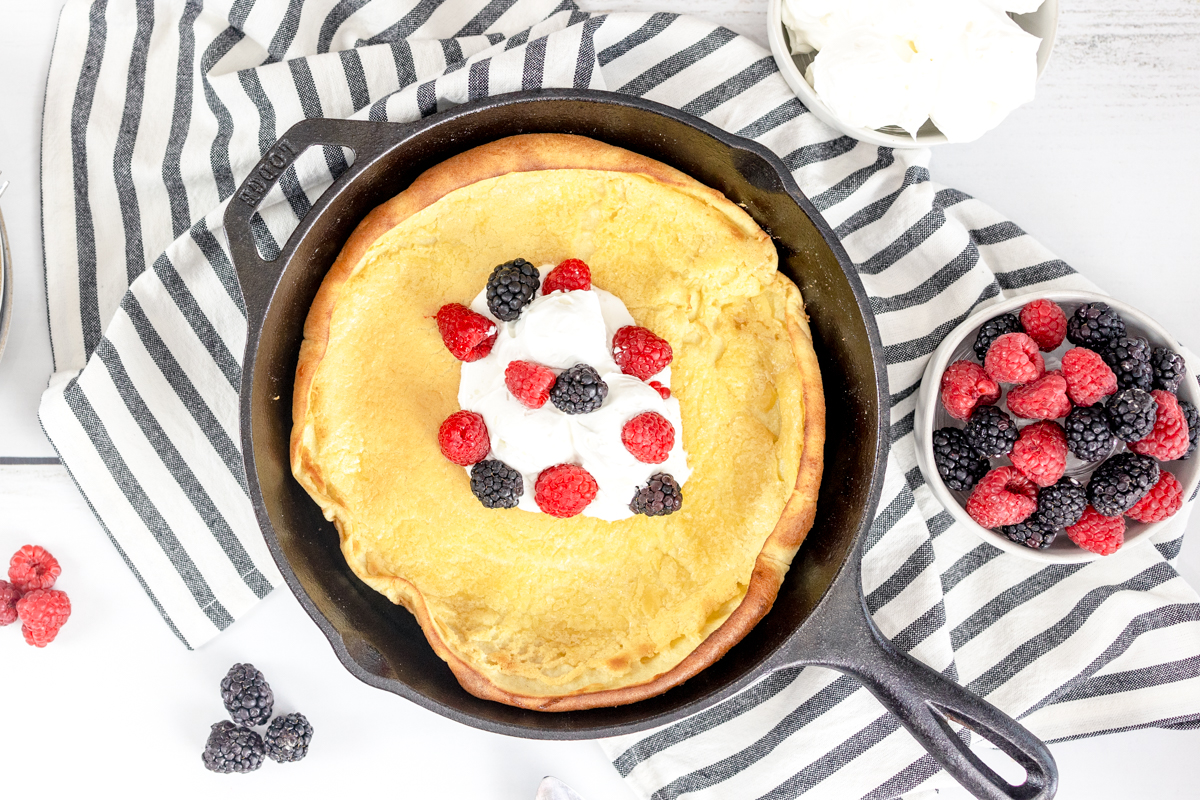 Dutch Baby or German Pancake with Whipping Cream and Fresh Berries
