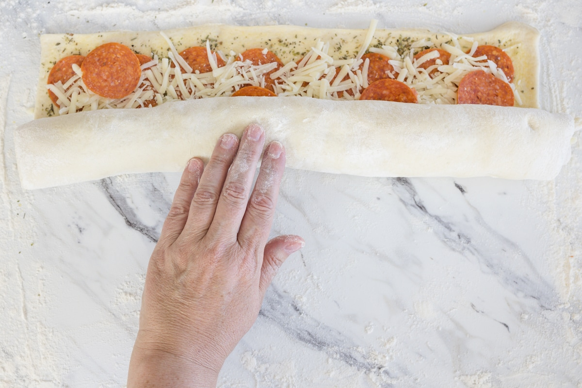 Roll Pizza into a log