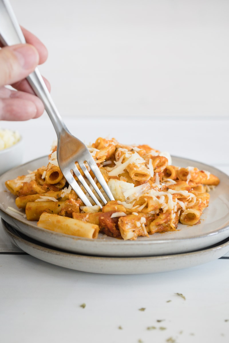 Sun Dried Tomato Pesto Pasta on plate with fork. Instant Pot Baked Ziti