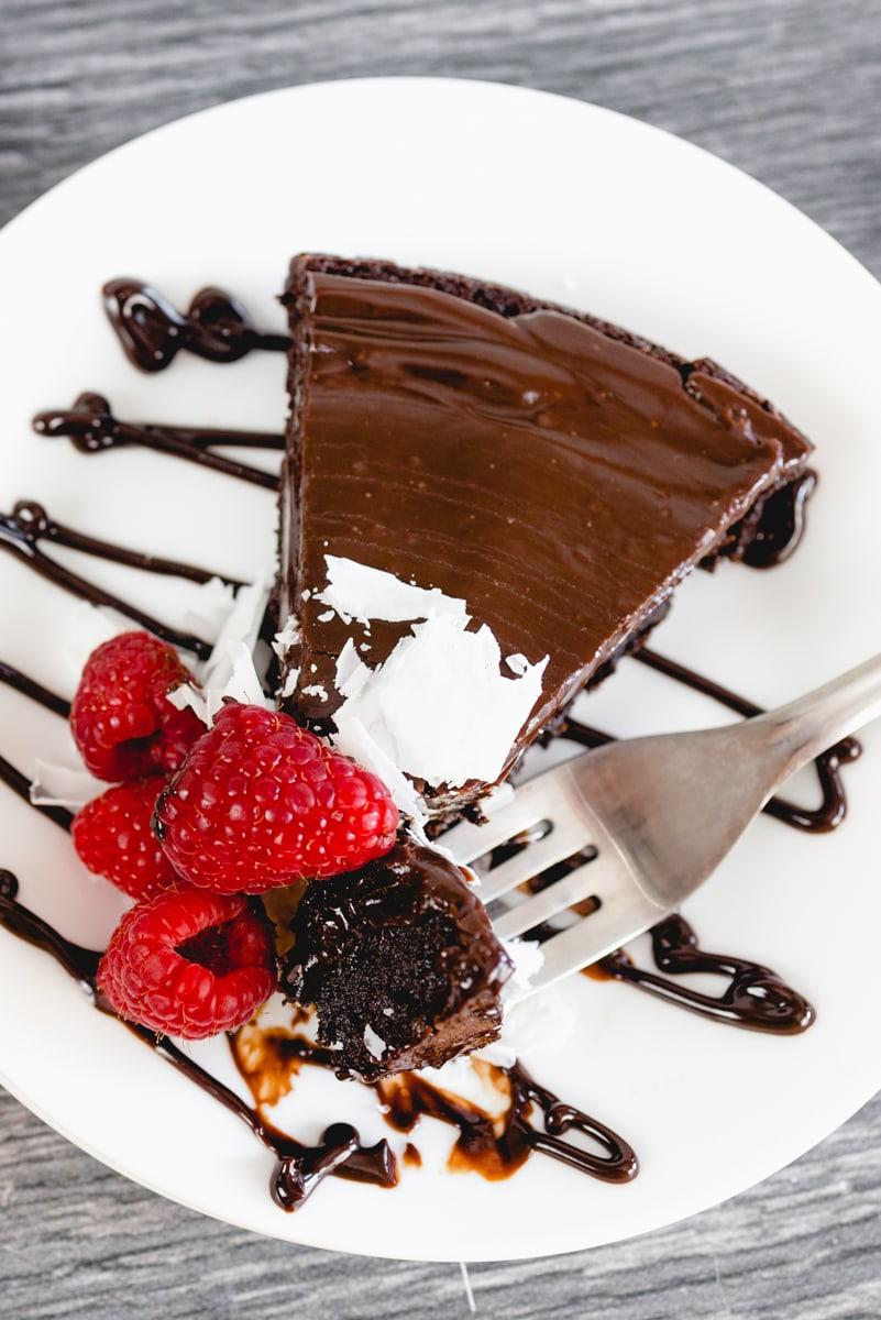 Flourless Chocolate Cake Recipe with fresh Berries on plate
