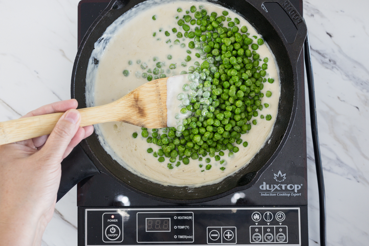 Add peas to cream sauce for Creamed Peas