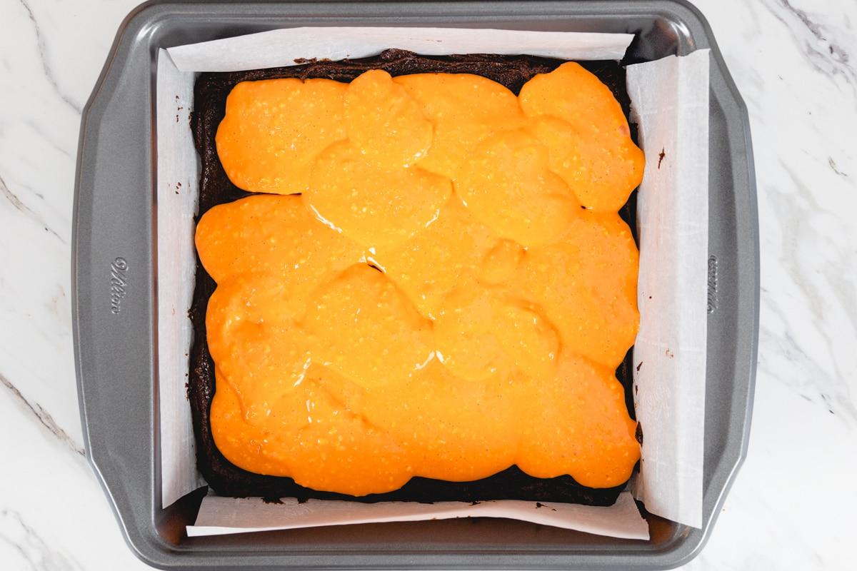Orange Cream Cheese mixture on brownie batter