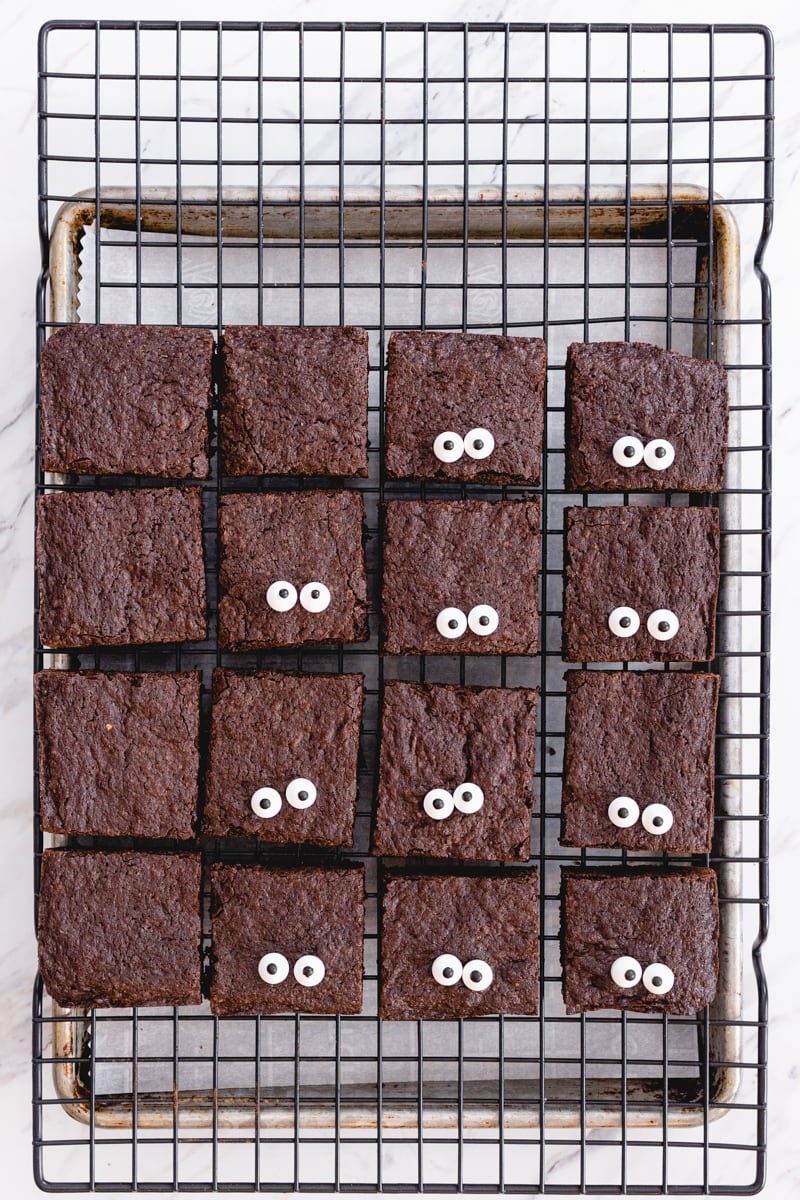 Cut brownies on cooling rack with candy eyeballs